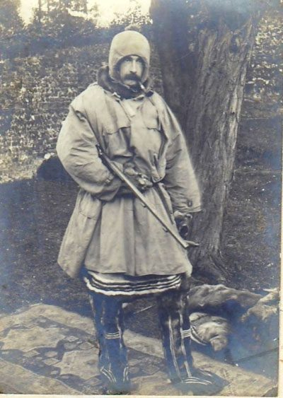 Reginald Koettlitz in northern polar attire with pipe and gun as used on Jackson-Harnsworth Expedition
